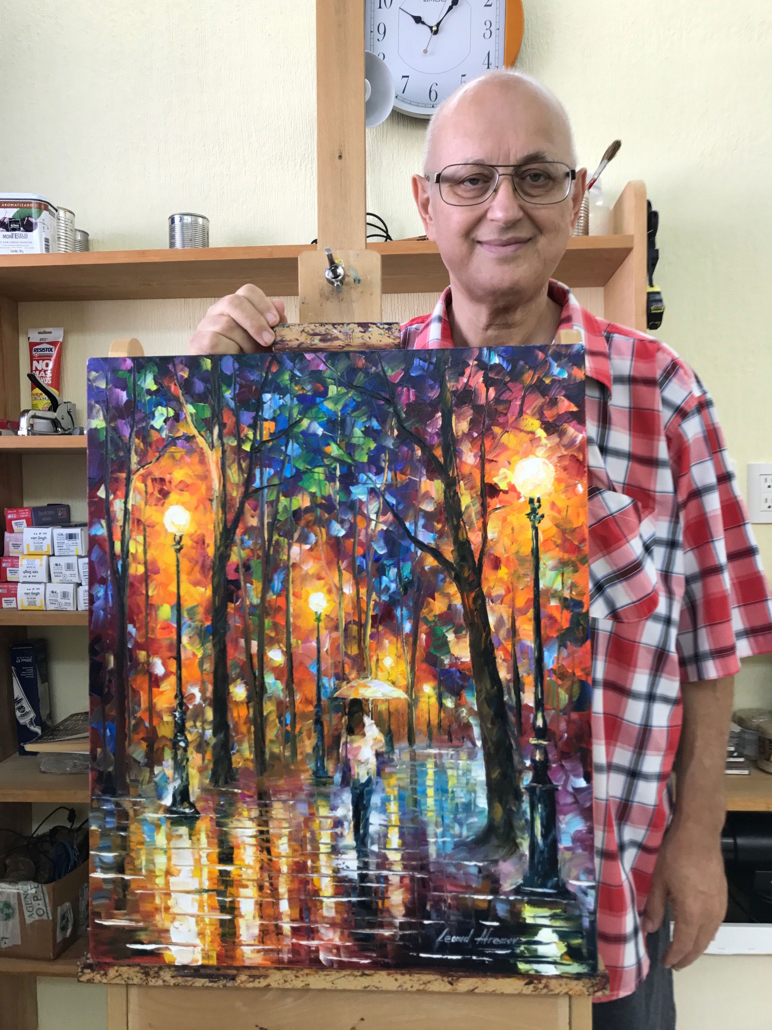 L'artiste devant sa peinture